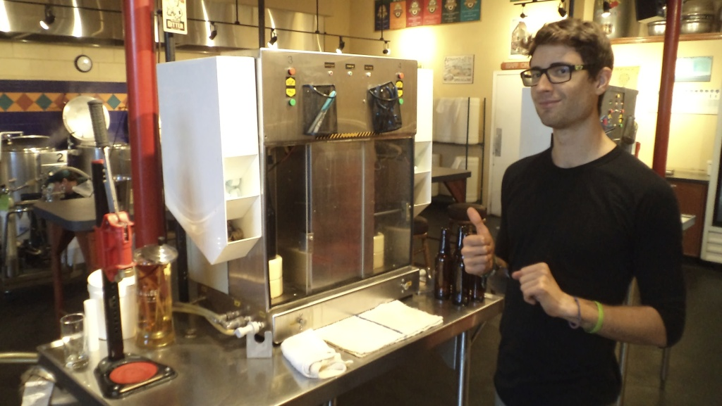 Spencer gives us a thumbs up at the filling machine.